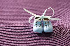 Small shoes. On the violet background Stock Image