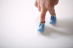 Small shoes. On the violet background Royalty Free Stock Photo
