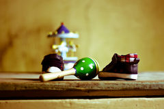 Small shoes and children`s games. Childhood should be beautiful for all children Royalty Free Stock Images