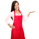 Small shop owner showing in apron royalty free stock photography