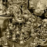 A small shop selling metal tableware at a market in Morocco stock images