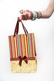 Small shopping bag in hand over white background. Gift bags Royalty Free Stock Photo