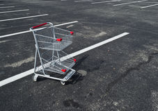 Small Shopping Cart Abandoned. In a parking lot in Prince Frederick, Maryland USA Royalty Free Stock Image