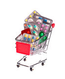Small shopping cart full of pills Royalty Free Stock Photo