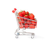 Small   shopping cart full of strawberry isolated Royalty Free Stock Photo
