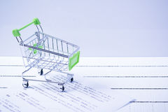 Small shopping cart and a teddy bear. Conceptual image for sale of toys or children's fantasies Stock Photo