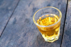 Small shot glass of alcoholic beverage Royalty Free Stock Images