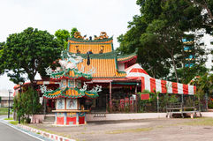 Small shrine in Chinese style beside street. Near footpath stock photos