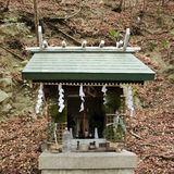 Small shrine in a forest in Japan Stock Photo