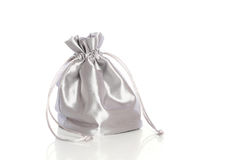 Small silk fashionable bag. With cord on white background Stock Photography
