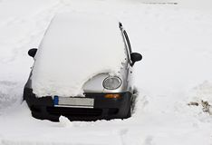Car under snow. Small silver car under snow Stock Images