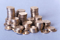 Small silver coins. A photo of small silver coins in columns Stock Photo