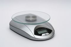 Small silver kitchen scale Stock Images