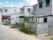 Small silver-painted houses in the fishing village Tai O on the island of Lantau, Hong Kong Royalty Free Stock Photo