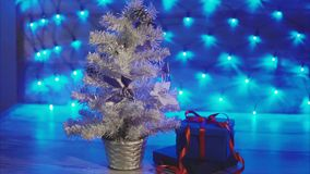 Small silver Xmas tree with gifts. Christmas and New Year celebration. stock footage