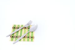 Small silverware on glass plate Stock Photo