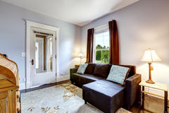 Small simple room with couch and floral rug Royalty Free Stock Images