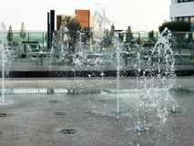 A small singing fountain in the open air, on the street. Drops of water, jets of water frozen in the air in flight.  stock images