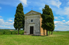 Small single chappel in Tuscany. Photo shows small single chappel in Tuscany, away from any building. The chappel is surrounded by cyprysses. Midday sun makes Royalty Free Stock Photo