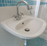 Small Sink. A small sink located in an en-suite bathroom Stock Photos