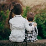 Small sister and brother hugging Stock Photo