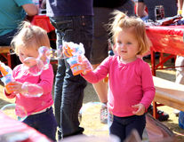 Small Sisters Playing with Bubbles at Festival South Africa Royalty Free Stock Images