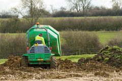 A small site dumper truck tipping load Stock Photography
