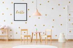 Small size furniture for kids. In golden and pink room royalty free stock photo