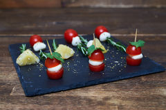 Small skewers with grapes and pieces of feta cheese Royalty Free Stock Photo