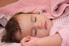 The small sleeping girl Stock Images