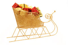 Small sleigh with christmas gifts. Cute golden sleigh with holiday gifts on white Royalty Free Stock Photos