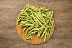 Small and slender green beans (haricot vert) on a wood. Fresh vegetable stock photography