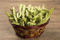 Small and slender green beans (haricot vert) on a wood. Fresh vegetable royalty free stock image