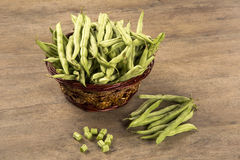 Small and slender green beans (haricot vert) on a wood. Fresh vegetable stock photo