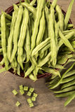 Small and slender green beans (haricot vert) on a wood. Fresh vegetable royalty free stock photo
