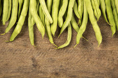 Small and slender green beans (haricot vert) on a wood. Fresh vegetable stock photos