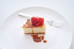 Small slice of cheesecake on a big plate Royalty Free Stock Images