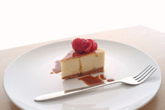 Small slice of cheesecake on a big plate Stock Image