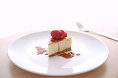 Small slice of cheesecake on a big plate Stock Photos