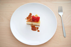 Small slice of cheesecake on a big plate Stock Photo
