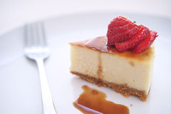 Small slice of cheesecake on a big plate Royalty Free Stock Photo