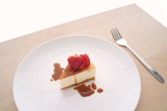 Small slice of cheesecake on a big plate Royalty Free Stock Photography