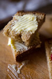 Small sliced piece of wheat bread and butter Royalty Free Stock Photos