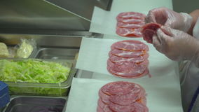 Small slices of salami being prepared for sandwiches stock video footage