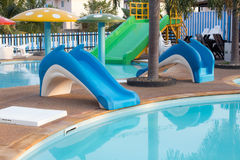 Small slider in public water park. Kids Royalty Free Stock Images