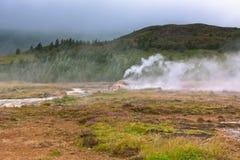 Iceland: Smidur Geyser at overcast weather Stock Photo