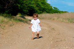 Small smile child in the white dress Stock Photography