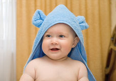 Small smiling baby in blue towel #4 Royalty Free Stock Images