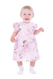 Small smiling baby girl in pink dress Royalty Free Stock Photos