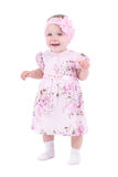 Small smiling baby girl in pink dress Royalty Free Stock Images